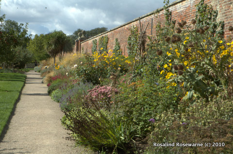 Orchard and herbaceous borders inbetween walls of the Walled Vegetable Gardens